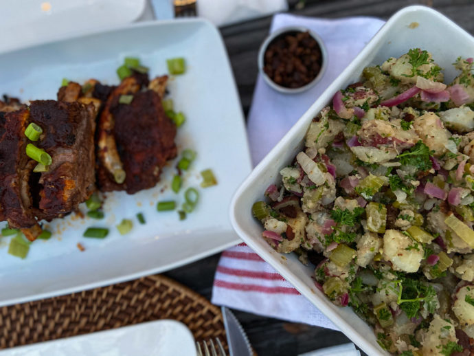 side warm german potato salad served with ribs